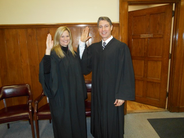 Among officials sworn in Jan. 2 by Circuit Judge Tom Cooper, right, was Howard County District Judge Jessica Steel-Gunter. In the audience in the county courtroom was State Rep. Justin Gonzales.