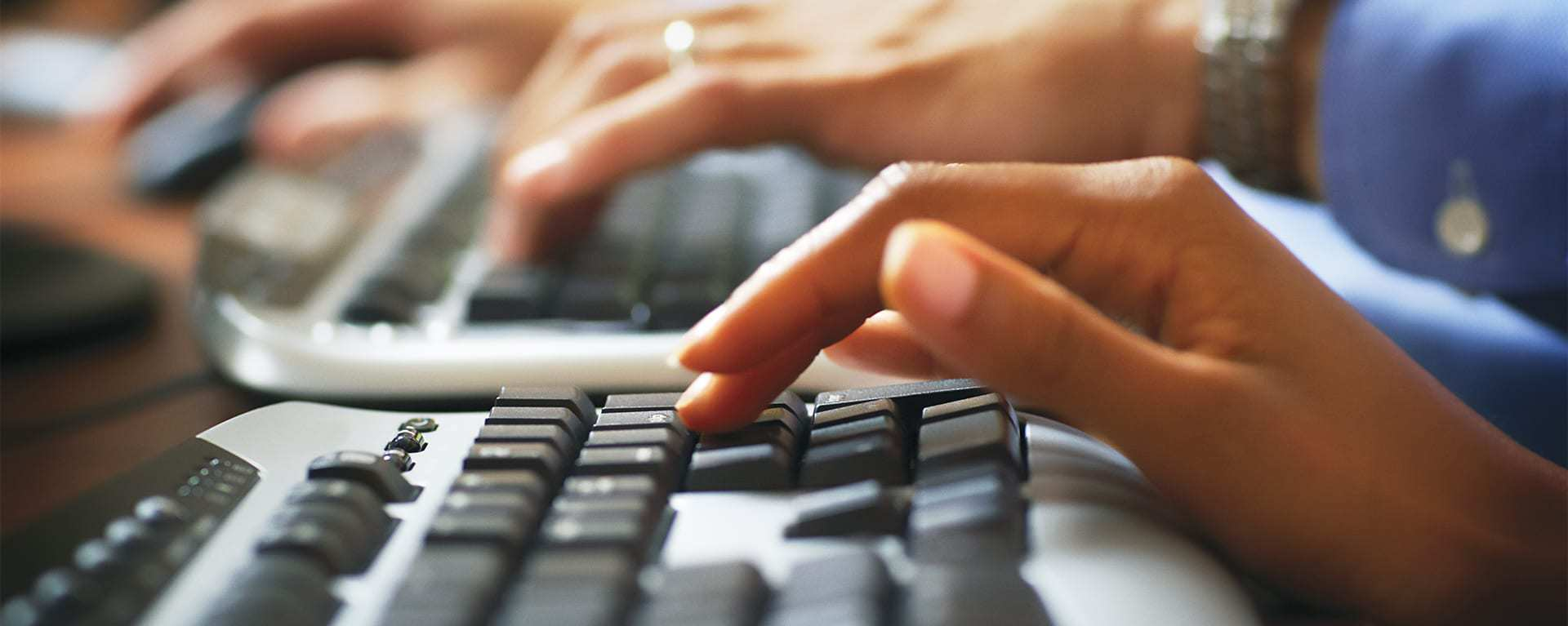 Image of Contact Center agents typing on a keyboard – Swartz Consulting LLC