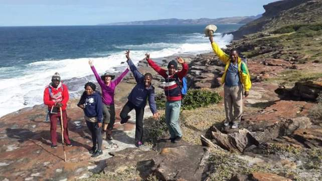 Hiking guides, hosts and tourists enjoy the Wild Coast
