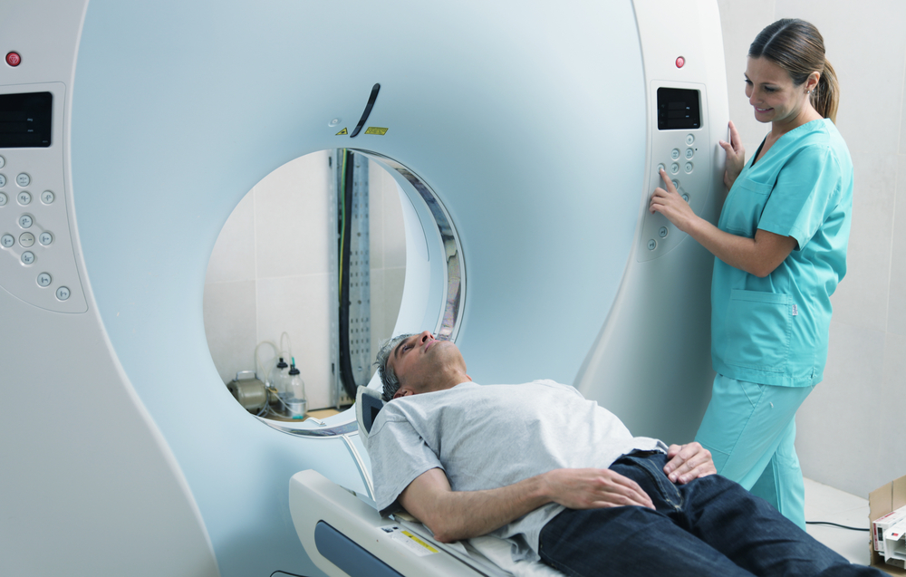 Male patient waiting to get CT scan