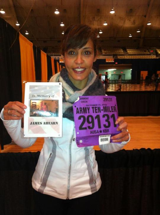 L with her bib number, and running in memory of her hubby who died fighting in Iraq.