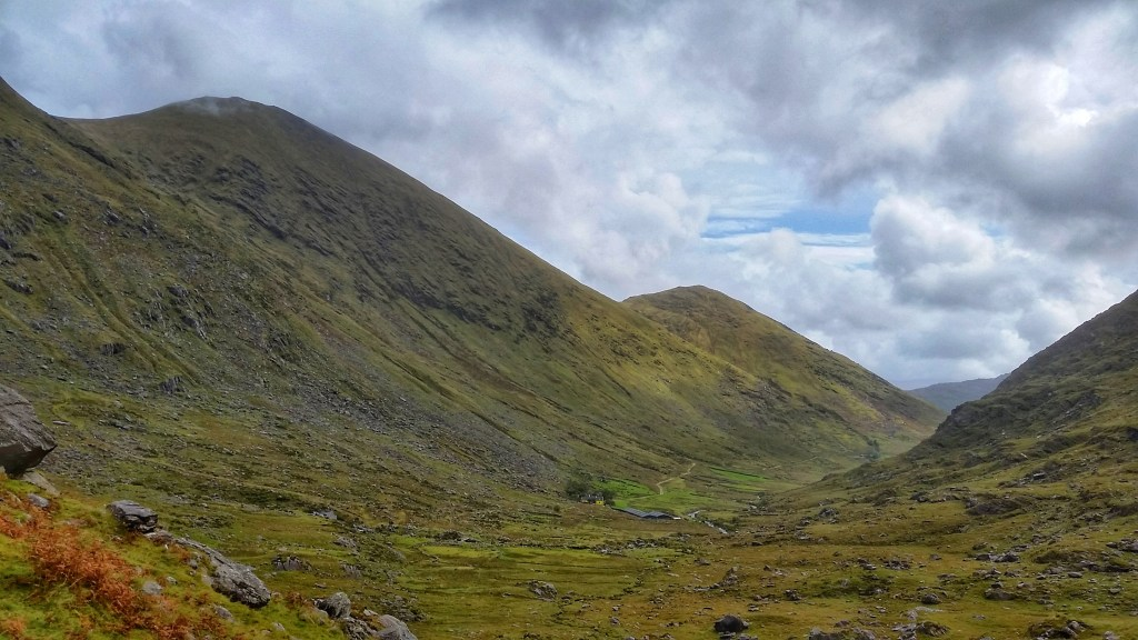 Broagnabinnia Mountain on the left stands above the Black Valley. In the distance, you can see the Kerry Way winding up to this gorgeous path which marks the entrance to Bridia Valley. Photo: Sara Weaver, Sept. 2017.