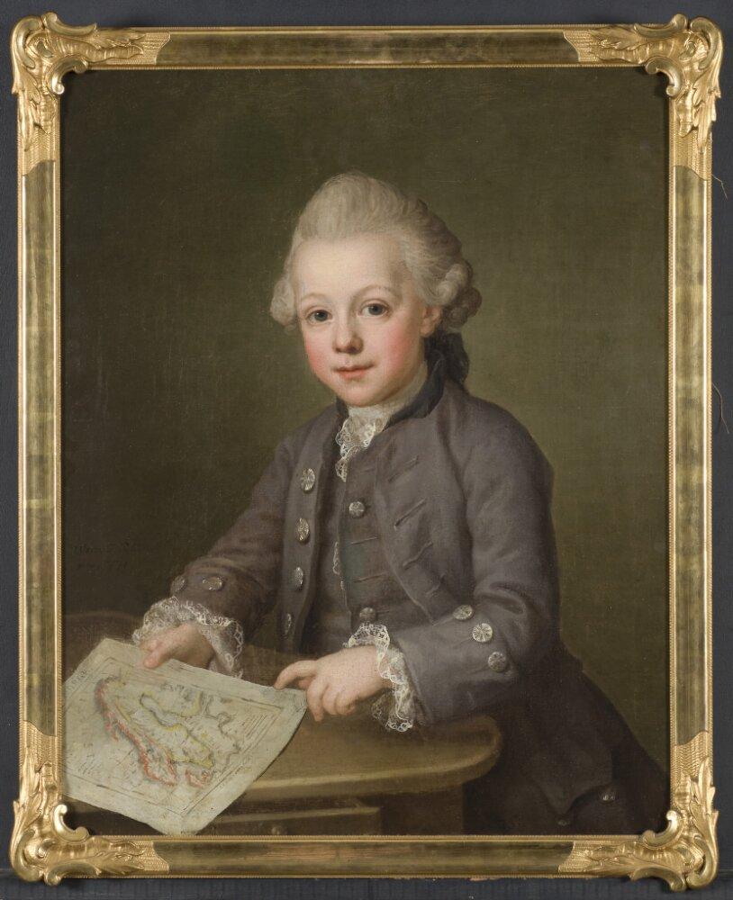 Boy with map of Scandinavia