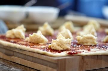 almond-raspberry-sweet-rolls-being-filled