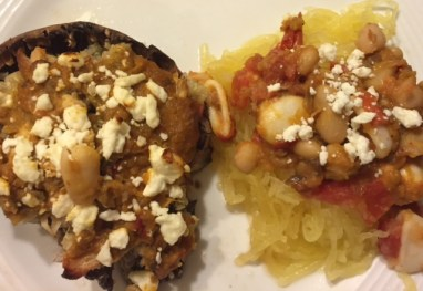 Portabello mushroom caps stuffed with Kidney bean, tomato, chicken, eggplant spread & feta