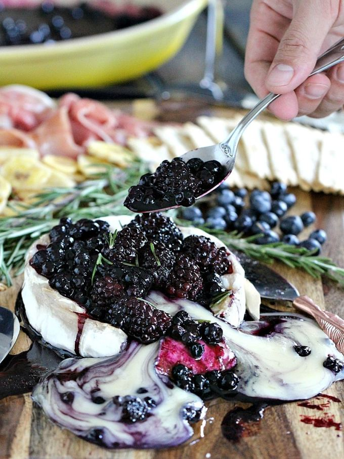 Rosemary Berry Baked Brie is a creamy and flavorful showstopper appetizer. Topped with coconut oil roasted berries and fresh rosemary.