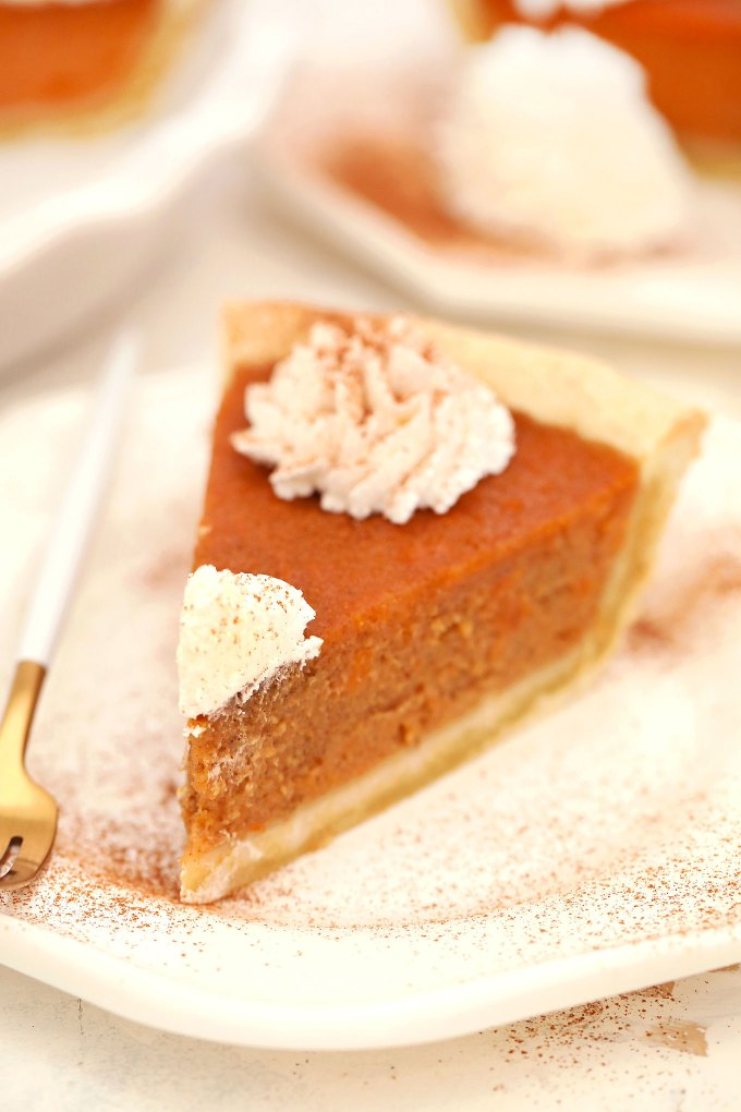 Sweet Potato Pie has a buttery crisp crust and creamy filling with nutmeg, cloves, ginger, and cinnamon. This is the perfect dessert to enjoy for Thanksgiving and Christmas. #thanksgivingrecipes #sweetpotatoes #sweetpotatopie #christmasrecipes #sweetandsavorymeals