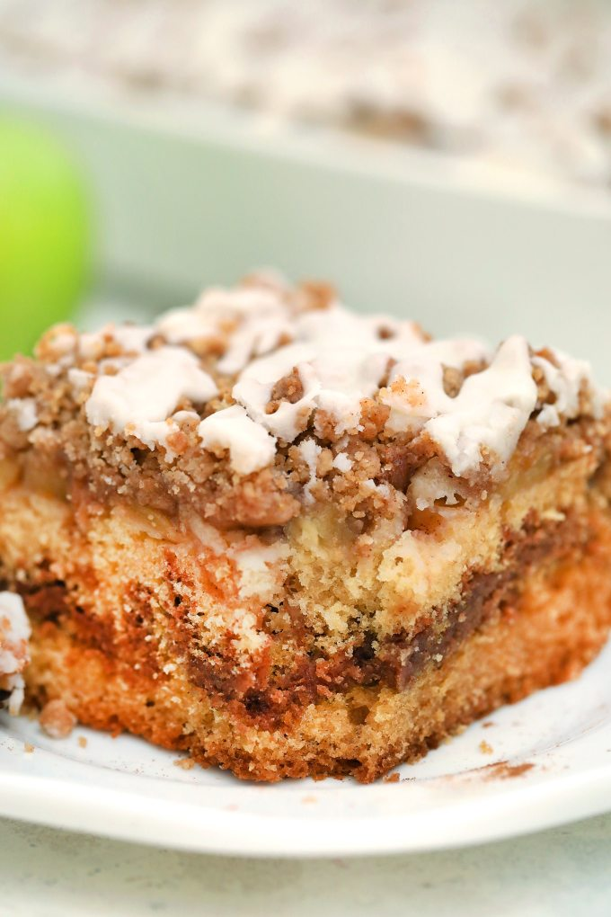 Apple Pie Coffee Cake is the perfect dessert for fall! It is dense and flavorful, made with apple pie filling and a delicious cinnamon spice streusel! #coffeecake #applerecipes #fallrecipes #applepie #sweetandsavorymeals