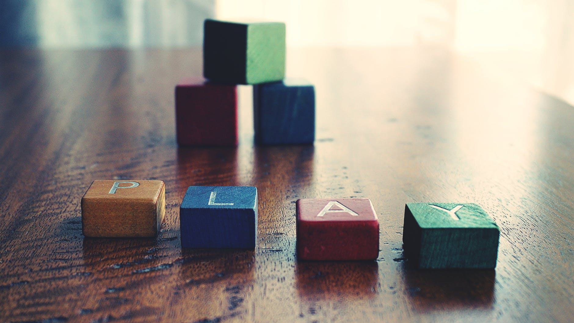 conceptual photo of word play spelled by wooden blocks