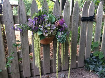 A garden gate adornment to welcome visitors!