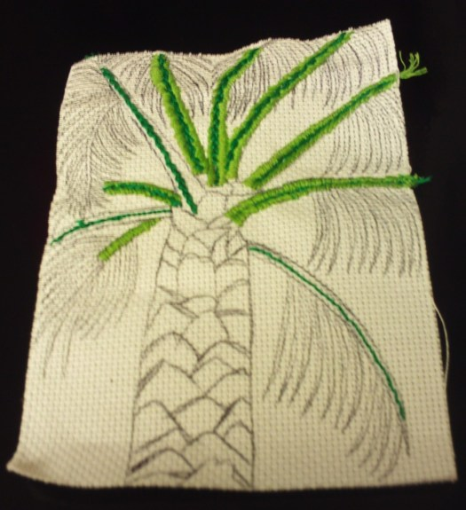 Cross stitching on the light green portion of the branches.