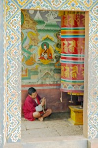 Bhutanese Man with Prayer Wheel