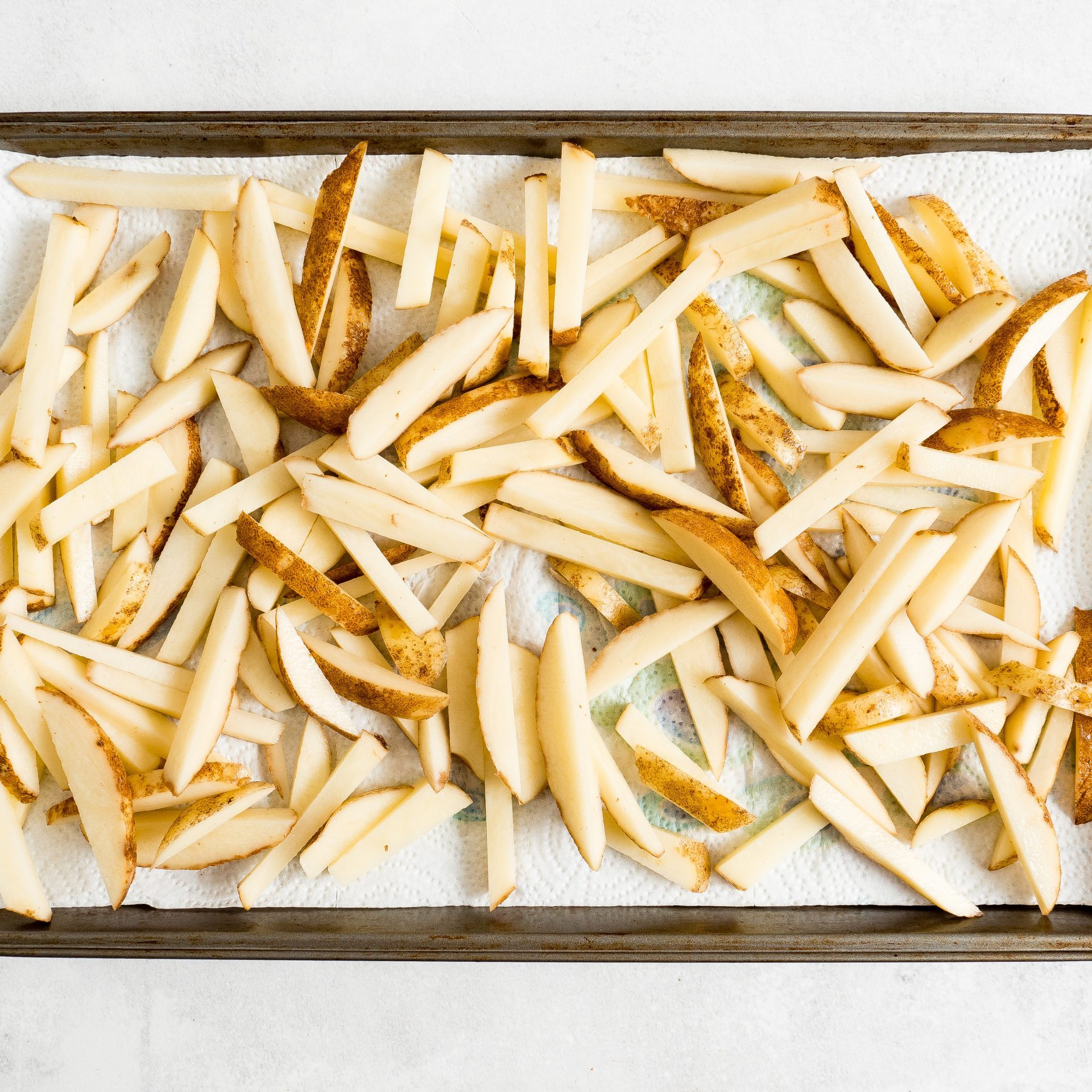 french fries drying on paper towel picture