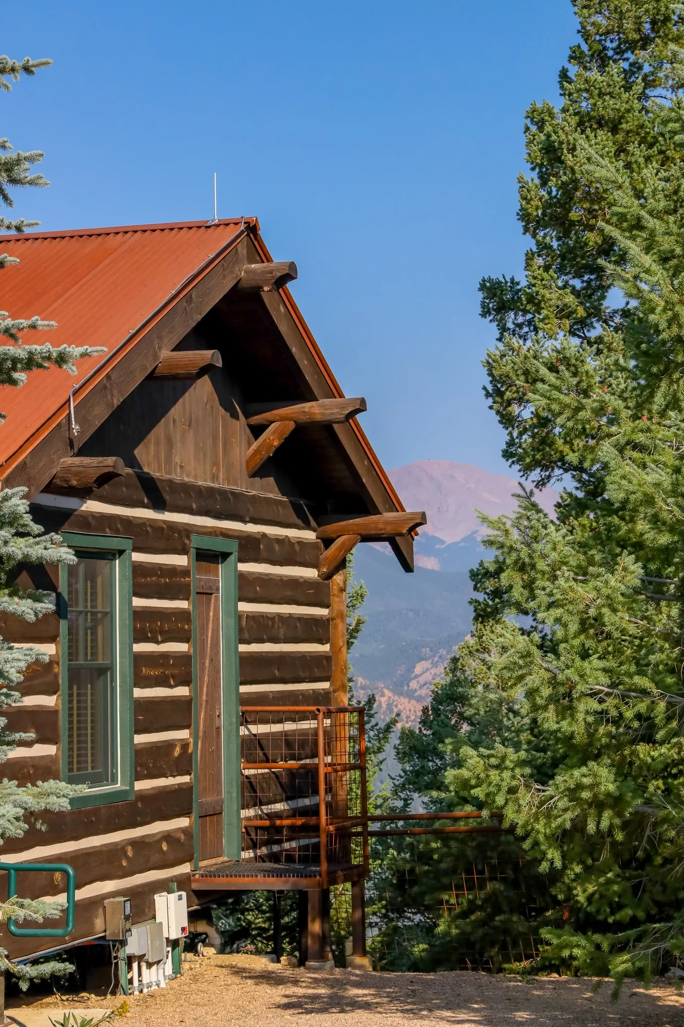picture of a cabin with view of pikes peak