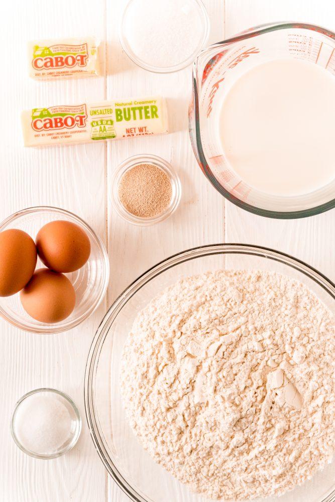yeast, butter, flour, eggs, salt on a table