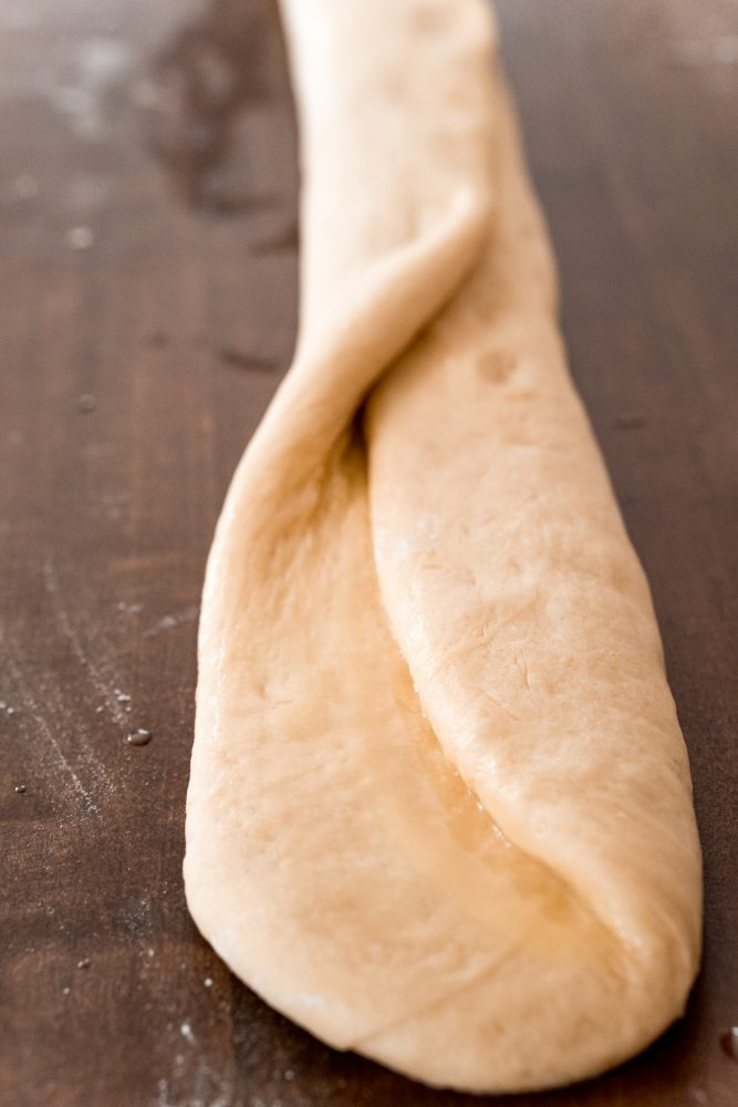 picture of bread roll being folded on table