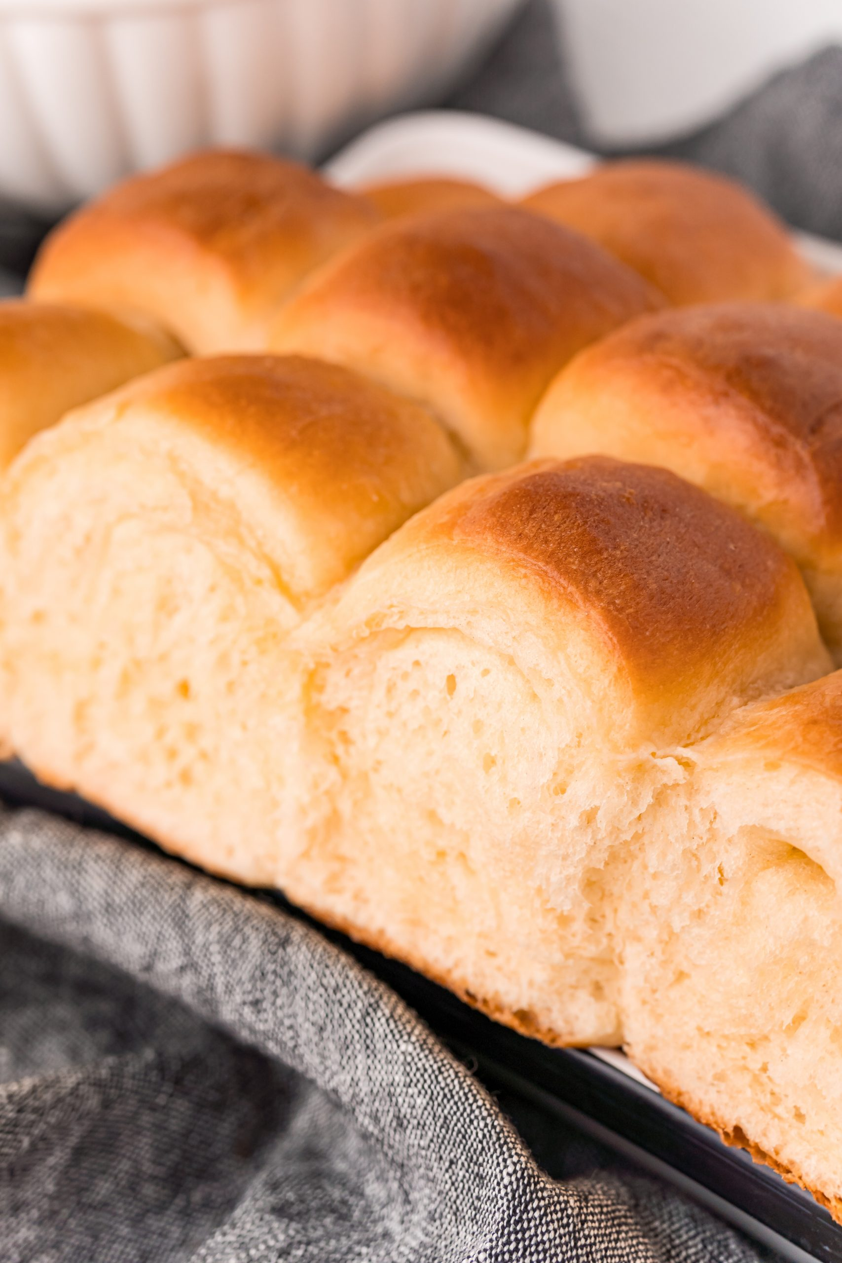 picture of soft dinner rolls on a towel