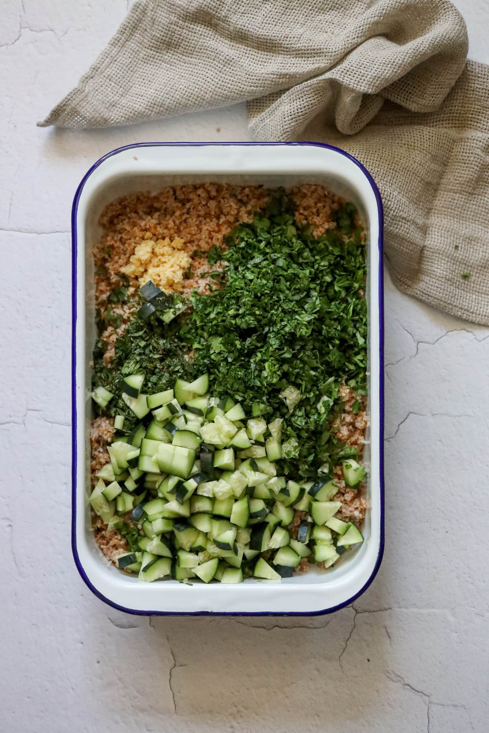 picture of bulgur with parsley mint green onion garlic and cucumbers