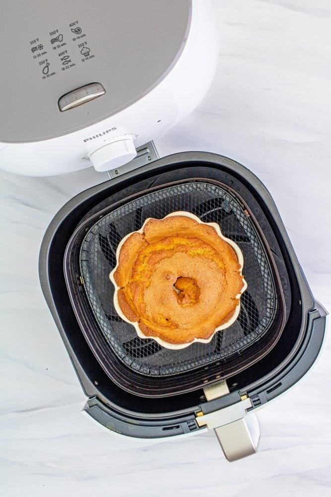picture of baked bundt cake in an air fryer basket