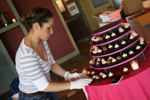 Carrie starts to build the cupcake tower...