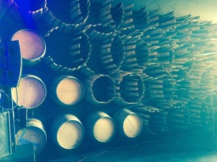 Wine barrels artistically arranged on a wall.