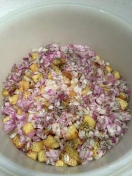 Roasted potato salad tossed before dressing.