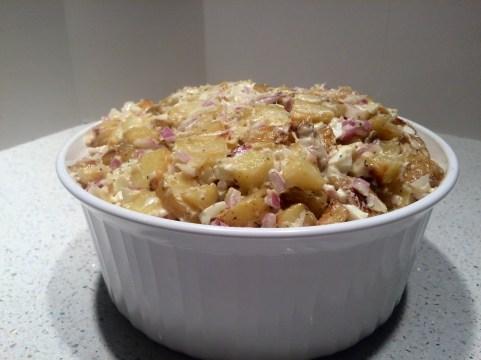 Roasted potato salad with dressing.