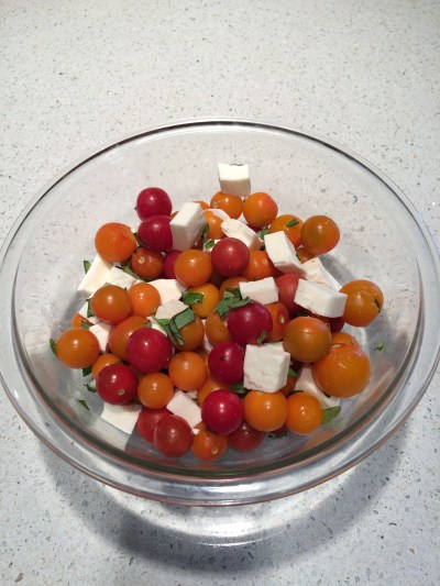 Home grown tomatoes and basil with fresh mozzarella chunks.