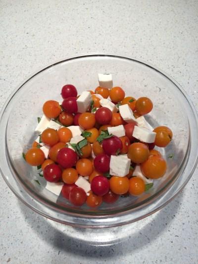 Home grown tomatoes and basil with fresh mozzarella chunks.