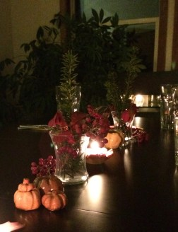 candles and hand made pumpkins with garden treasures