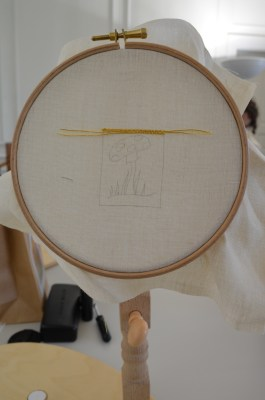 Starting to couch the first two lines of gold thread.