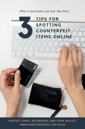 A woman holds her credit card with one hand and types on the computer with another as she prepares to make a purchase online.
