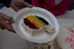 Red velvet, orange frosting, yellow cake, green frosting, then red velvet dyed blue.