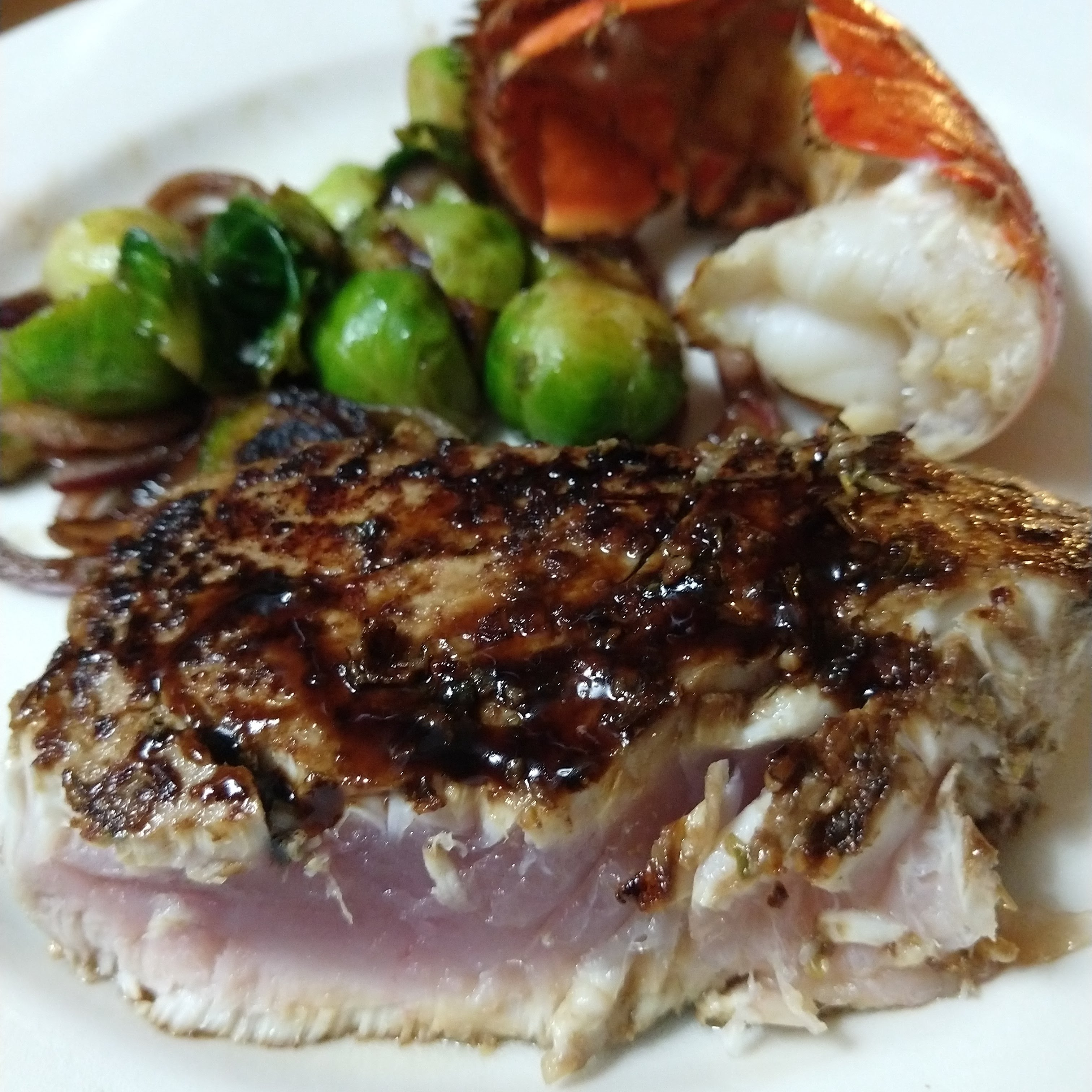 Ahi tuna with brussels sprouts and lobster