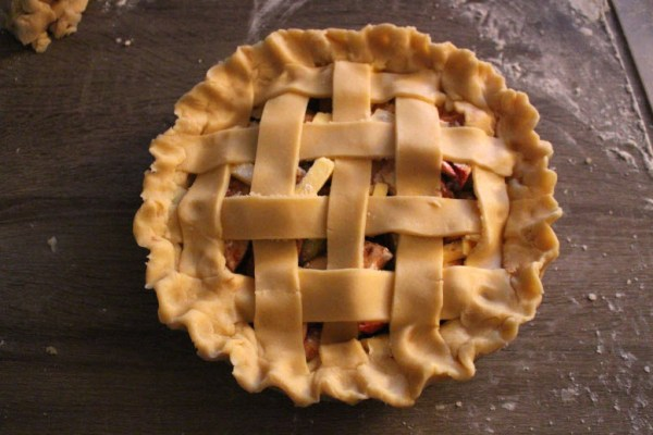 Fluting the edge of apple pie