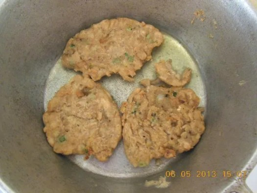 Jamaican food - Salt fish fritters fry until golden and crispy