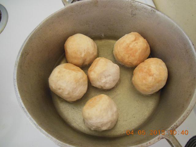 Fry dumplings in oil until golden brown