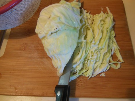 Thinly slice the cabbage into ribbons