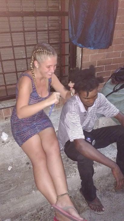 Practising hairdressing, downtown Kingston