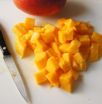 Peel and dice mangoes