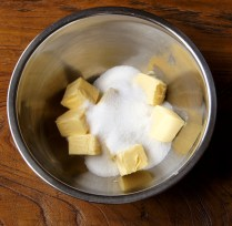 Place sugar and butter in a bowl