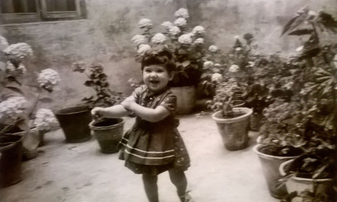 Patio with plants and child