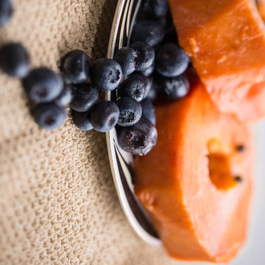 cropped-blueberries-accented-papaya-slices-1-2