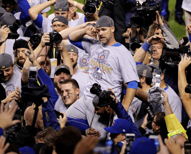 David Ross carried by his teammates. Photo taken by Gene J. Puskar of The Associated Press and appeared on nytimes.com