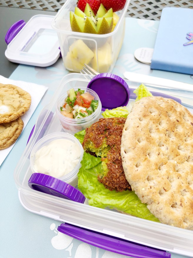 Leftovers for lunch - falafel with condiments in separate containers