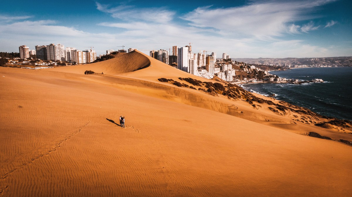 Drone shot of the Concon Dunes with Vina Del Mar city in the background