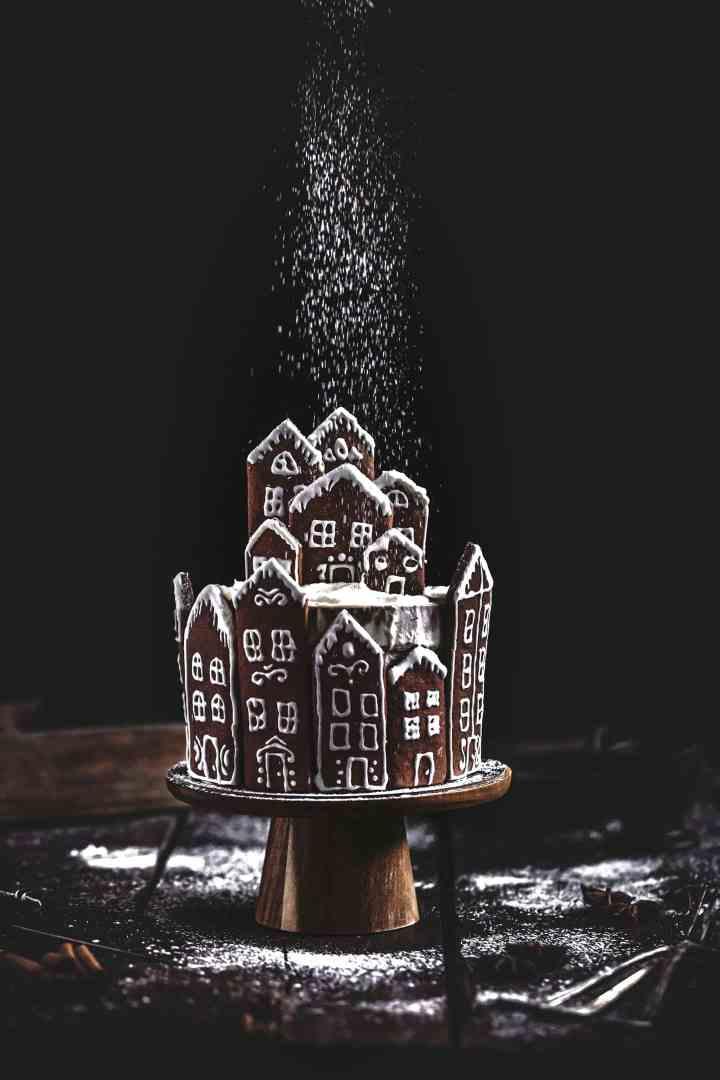 Gingerbread snow village layer cake
