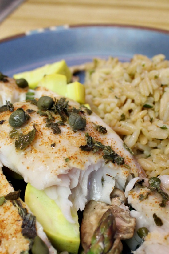 Moist flaky tilapia served over yellow squash, mushrooms, and asparagus.