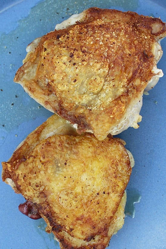 Pan fried chicken thighs.