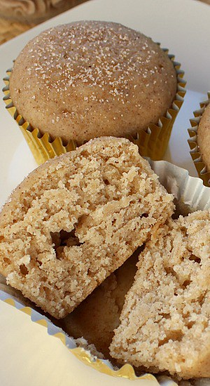 Muffin sliced open, top sprinkled with cinnamon and sugar.